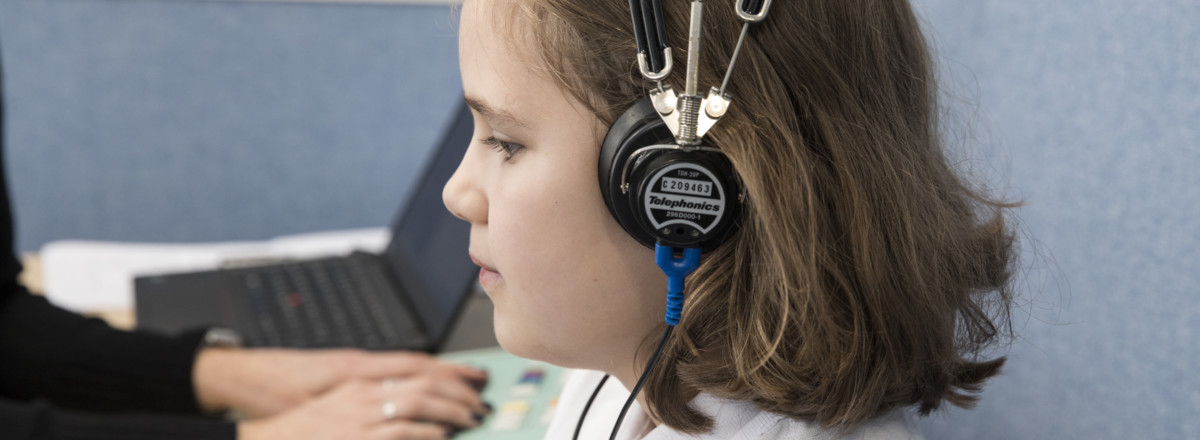 Child undergoing hearing test with headphones on