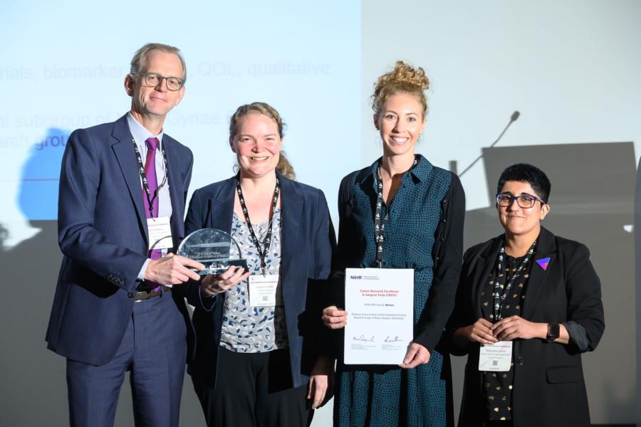 Dr Richard Shaw, NIHR, presenting CREST award to Professor Emma Crosbie and Dr Chloe Barr, with Dr Shamaila Anwar, NIHR