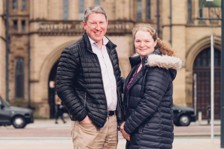 Dr Phil Crosbie and Professor Emma Crosbie smiling and staring straight at the camera